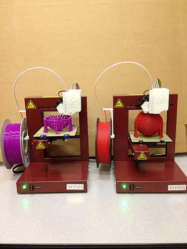 Two Afinia printers working on designs by @dizingof